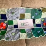 Crchet blanket with stitches for survival sign