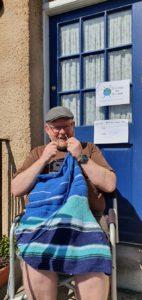 Man knitting in blue yarn